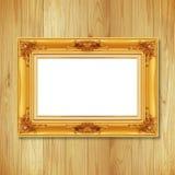 Παλαιό χρυσό πλαίσιο στον ξύλινο τοίχο  Κενό πλαίσιο εικόνων στο μόριο Στοκ Φωτογραφία