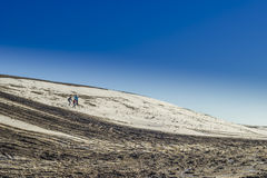 Πεζοπορία στο χιόνι και τη λάσπη Στοκ Φωτογραφίες