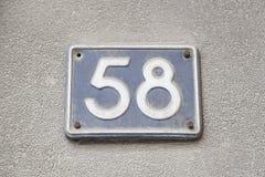 Πενήντα οκτώ αριθμός στον τοίχο ενός σπιτιού Στοκ φωτογραφία με δικαίωμα ελεύθερης χρήσης