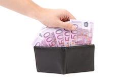 Πεντακόσια ευρώ στο πορτοφόλι και το χέρι. Στοκ Εικόνα