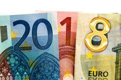 Περίβολος επάνω που γράφεται το 2018 με τα τραπεζογραμμάτια ευρώ Στοκ εικόνες με δικαίωμα ελεύθερης χρήσης