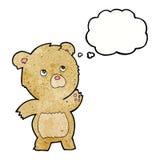 περίεργος teddy κινούμενων σχεδίων αντέχει με τη σκεπτόμενη φυσαλίδα Στοκ Εικόνες
