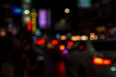 Περίληψη θαμπάδων bokeh του ελαφριού υποβάθρου νύχτας πόλεων οδών Στοκ Εικόνα