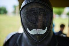 Περίφραξη μασκών, μαύρη με ένα mustache στοκ εικόνες