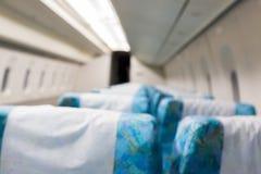Περίληψη που θολώνεται μέσα του τραίνου με την εσωτερική θαμπάδα άδειων θέσεων Στοκ φωτογραφίες με δικαίωμα ελεύθερης χρήσης
