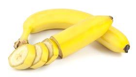 Περικοπή και τεμαχισμένες φρέσκες μπανάνες Στοκ Εικόνες