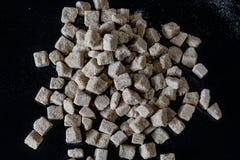 περιορισμένη πεδίο ζάχαρη βάθους ανασκόπησης μαύρη καφετιά Στοκ εικόνα με δικαίωμα ελεύθερης χρήσης