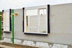Περιοχή κτηρίου των σπιτιών με τα πλαίσια παραθύρων Στοκ Φωτογραφία