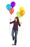 Περιστασιακός: Γυναίκα που προσπαθεί στο χαλαρό βάρος με τα μπαλόνια Στοκ φωτογραφία με δικαίωμα ελεύθερης χρήσης