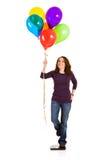 Περιστασιακός: Γυναίκα που προσπαθεί στο χαλαρό βάρος με τα μπαλόνια Στοκ Εικόνες