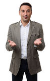 Περιστασιακός επιχειρηματίας με το βραχίονα έξω σε μια χειρονομία υποδοχής Στοκ φωτογραφίες με δικαίωμα ελεύθερης χρήσης