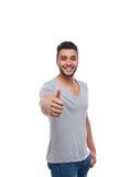Περιστασιακός τύπος χαμόγελου αντίχειρων λαβής ατόμων νέος όμορφος επάνω ευτυχής Στοκ Φωτογραφίες