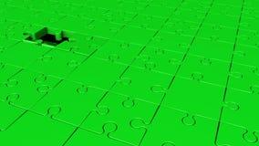 Περιστρεφόμενα κομμάτια γρίφων σε πράσινο ελεύθερη απεικόνιση δικαιώματος