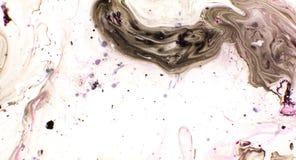 Περιστροφή παφλασμών χρωμάτων στο νερό r στοκ φωτογραφίες