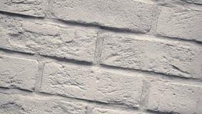 Περιστροφή των άσπρων διακοσμητικών τούβλων για το σπίτι Υπόβαθρο πλινθοδομής Φραγμός αριθμού απόθεμα βίντεο
