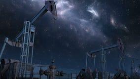 Περιτυλιγμένη κίνηση κατά μήκος των γρύλων αντλιών πετρελαίου κάτω από το νυχτερινό ουρανό