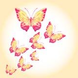 Πεταλούδες Watercolor σε ένα μπεζ υπόβαθρο Στοκ φωτογραφία με δικαίωμα ελεύθερης χρήσης