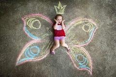 Πεταλούδα μικρών κοριτσιών, ΕΚΠΛΗΞΗ Στοκ Εικόνες