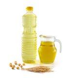 Πετρέλαιο πίτουρου ρυζιού στο γυαλί μπουκαλιών με το ρύζι και τη σόγια Στοκ Φωτογραφία