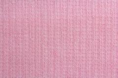 Πετσέτες βαφλών σύστασης υφάσματος στο κλουβί, ροζ Στοκ Φωτογραφίες