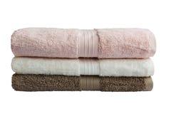 Πετσέτες λουτρών στο σωρό που απομονώνεται Στοκ Φωτογραφία