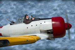 Πετώντας αεροπλάνο πιλότων πολεμικού αεροσκάφους άσσων στη μάχη Στοκ εικόνες με δικαίωμα ελεύθερης χρήσης