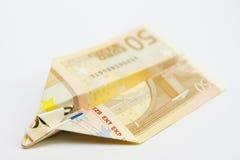 Πετώντας χρήματα αεροπλάνων εγγράφου Στοκ Φωτογραφίες