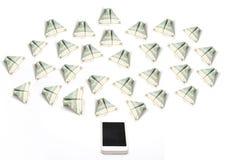 Πετώντας χρήματα από το κινητό τηλέφωνο Στοκ Φωτογραφίες