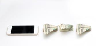 Πετώντας χρήματα από το κινητό τηλέφωνο Στοκ εικόνες με δικαίωμα ελεύθερης χρήσης