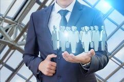 Πελάτες στόχων στο χέρι ενός επιχειρηματία Στοκ φωτογραφίες με δικαίωμα ελεύθερης χρήσης