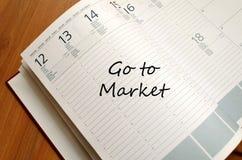 Πηγαίνετε στο σημειωματάριο έννοιας αγοράς στοκ εικόνα