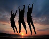 πηδώντας άνθρωποι τρία Στοκ Εικόνα