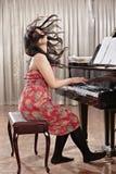 Πιάνο παιχνιδιού Στοκ Φωτογραφίες