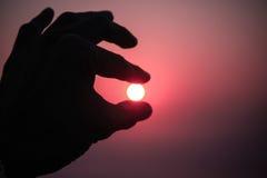 Πιάστε τον ήλιο Στοκ Εικόνες