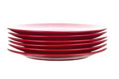 Πιάτα που απομονώνονται κόκκινα στο λευκό Στοκ φωτογραφία με δικαίωμα ελεύθερης χρήσης