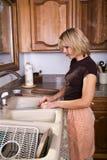πιάτα που κάνουν τη νοικο&k στοκ εικόνα