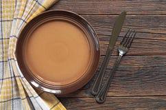 Πιάτο, δίκρανο και μαχαίρι Στοκ Εικόνα