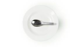 Πιάτο και κουτάλι Στοκ φωτογραφία με δικαίωμα ελεύθερης χρήσης