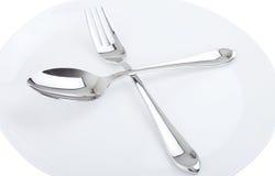 Πιάτο, κουτάλι και δίκρανο γευμάτων. Στοκ Φωτογραφία