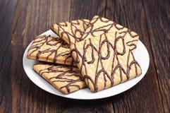 Πιάτο με τα μπισκότα σοκολάτας Στοκ Εικόνες
