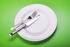 Πιάτο με το μαχαίρι και το δίκρανο Στοκ φωτογραφία με δικαίωμα ελεύθερης χρήσης