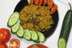 Πιάτο με το plov στο άσπρο υπόβαθρο Στοκ Φωτογραφίες