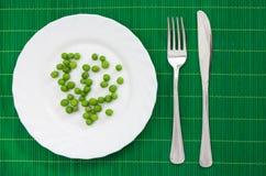 πιάτο πράσινων μπιζελιών πο&up Στοκ Εικόνα