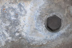 Πιάτο χάλυβα με ένα στριμμένο μπουλόνι Στοκ Φωτογραφία