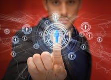 Πιέζοντας κουμπί επιχειρηματιών με την επαφή Στοκ Εικόνες