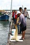 Πιασμένα ψαράς ψάρια Στοκ Φωτογραφία