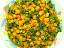 Πικάντικο chickpeas ή masala chana Στοκ Εικόνες