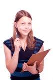 Πινέλο και έγγραφο εκμετάλλευσης κοριτσιών εφήβων Στοκ φωτογραφία με δικαίωμα ελεύθερης χρήσης