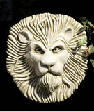 Πινακίδα γλυπτών κήπων προσώπου λιονταριών στοκ φωτογραφίες