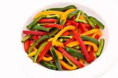 πιπέρια που τεμαχίζονται Στοκ Εικόνες